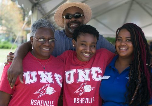 A family at UNC Asheville's Homecoming Picnic
